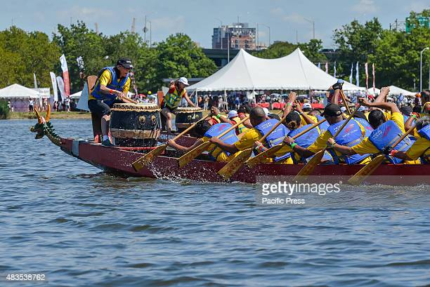 A dragon boat crew paddles furiously as they race to the finish line The twoday 25th Annual Hong Kong Dragon Boat Festival was held in Flushing...