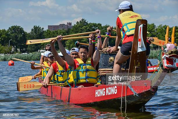 A dragon boat crew shows its oars at the conclusion of the race The twoday 25th Annual Hong Kong Dragon Boat Festival was held in Flushing...