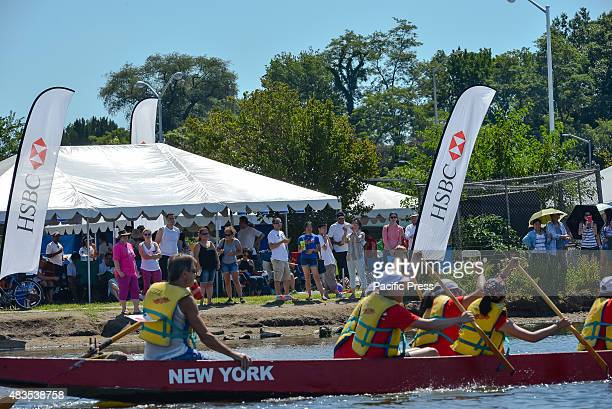 A dragon boat passes by the crowd of spectators gathered on shore The twoday 25th Annual Hong Kong Dragon Boat Festival was held in Flushing...