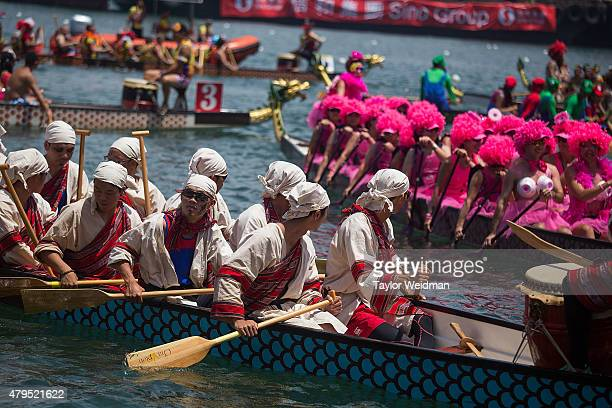 Dragon boat racers prepare for the fancy dress race on July 5 2015 in Hong Kong Hong Kong The Hong Kong Dragon Boat Carnival will be staged from 3...