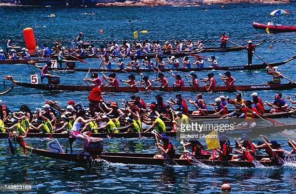 dragon boat races at stanley beach. - dragon boat festival stock pictures, royalty-free photos & images