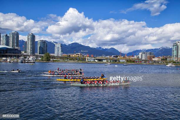 dragon boat racing at false creek, vancouver, canada - dragon boat festival stock pictures, royalty-free photos & images