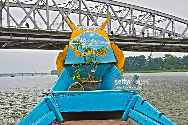 Dragon boat under the bridge at Hue Vietnam