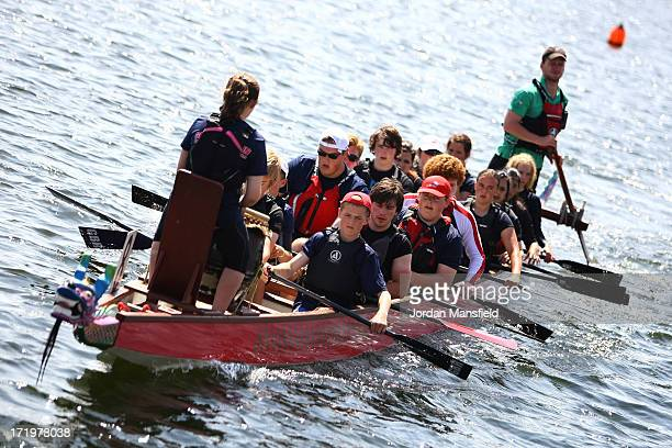 Dragon boats head to the start line before their race on June 30 2013 in London England The London Hong Kong Dragon Boat Festival has been held in...