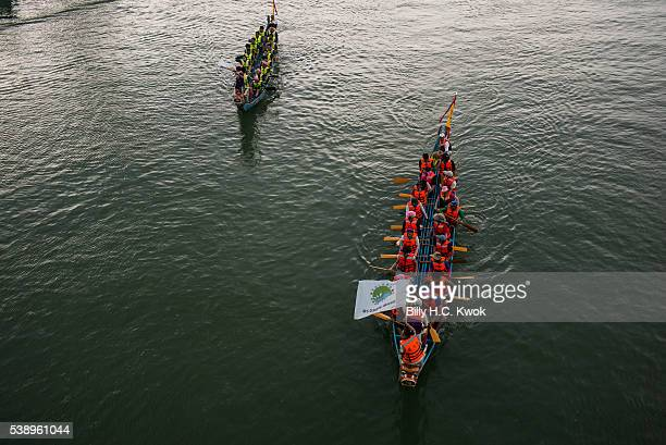 Dragon boats move down in the river celebrating the Dragon Boat Festival on June 9 2016 in Taipei Taiwan Cities across Asia celebrated Dragon Boat...