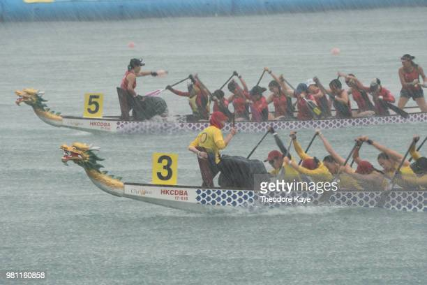 Costumed competitors cheer at the Hong Kong Dragon Boat Carnival on June 24 2018 in Hong Kong Hong Kong