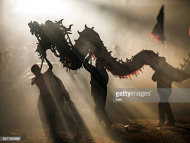 dragon bombing festival - chinese new year stock pictures, royalty-free photos & images