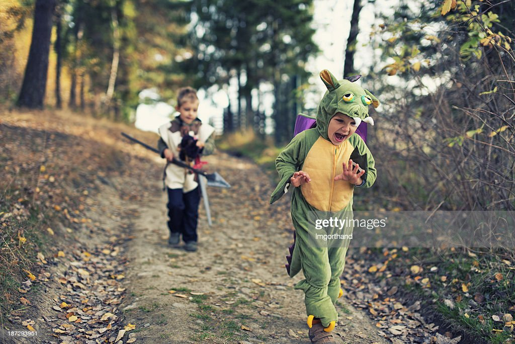 Dragon chased by a fearsome knight : Stock Photo