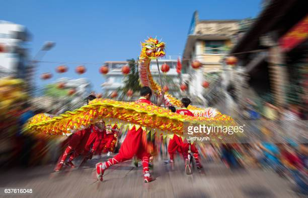 dragon dance (mua rong) - traditional dancing stock photos and pictures