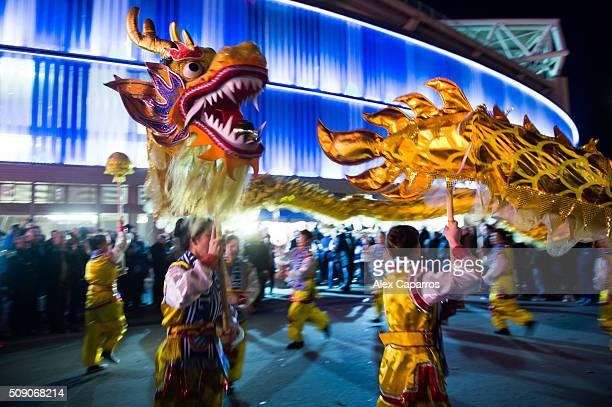 A dragon dance team performs during a Lunar New Year parade ahead of the La Liga match between RCD Espanyol and Real Sociedad de Futbol at CornellaEl...