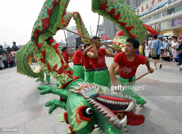 A dragon dance troupe performs at the opening ceremony of a summer temple fair in Shenyang northeastern China's Liaoning province 18 July 2005 So far...