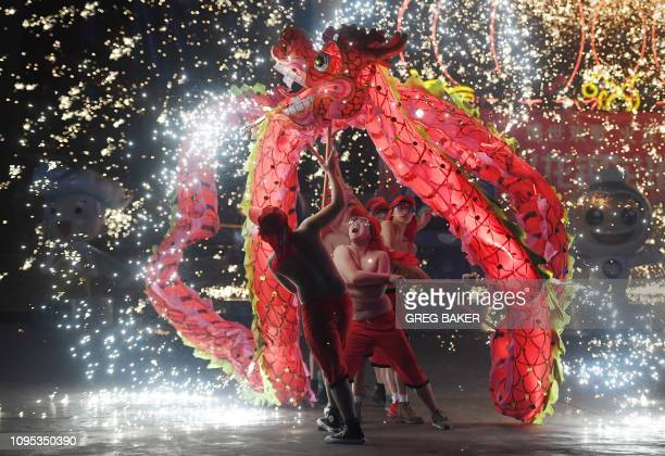 TOPSHOT Dragon dancers perform at a park in Beijing on the fourth day of the Lunar New Year on February 8 2019 China is marking the arrival of the...