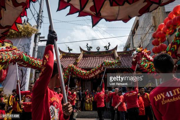 Dragon dancers perform during Grebeg Sudiro festival infront of Tien Kok Sie temple on February 11 2018 in Solo City Central Java Indonesia Grebeg...