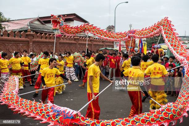 Dragon dancers perform in front of the Association of Khmer Chinese on January 30 2014 in Phnom Penh Cambodia Lion and Dragon dancers gathered today...