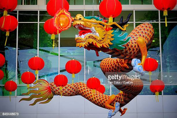 Dragon Decoration With Chinese Lanterns Hanging Against Building
