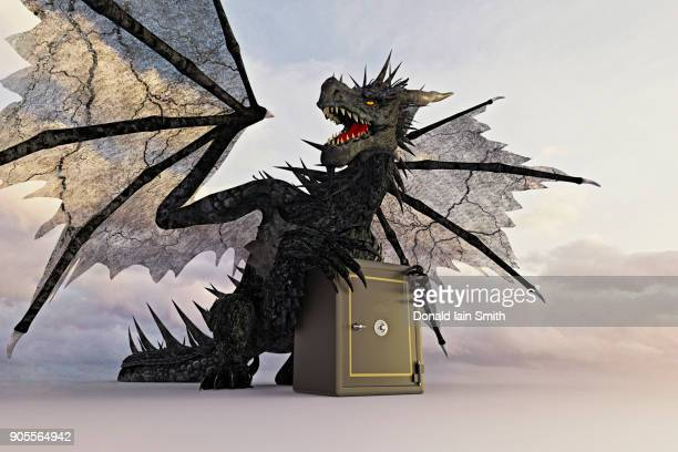 dragon guarding safe - dragon stock photos and pictures