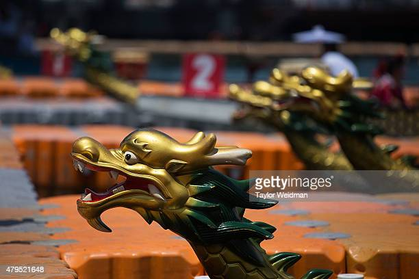 Dragon heads adorn the front of the racing boats on July 5 2015 in Hong Kong Hong Kong The Hong Kong Dragon Boat Carnival will be staged from 3 July...