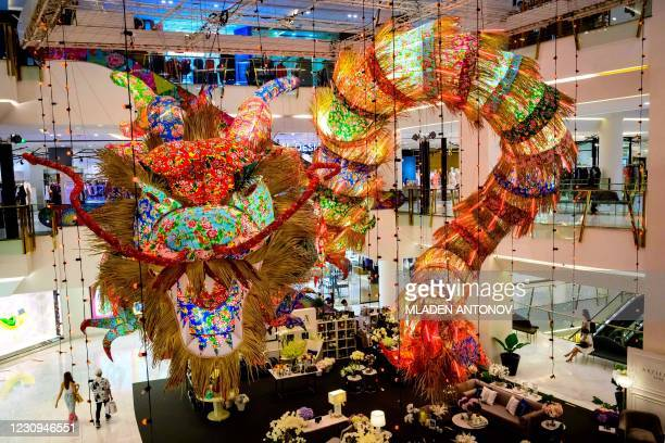 Dragon made out of giant lamp shades is suspended as a festive decoration for the upcoming Lunar New Year in a shopping mall in Bangkok on February...