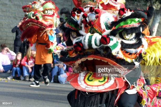 dragon masks dance february 16 2002 during the chinese new year golden dragon parade in the - Chinese New Year 2002