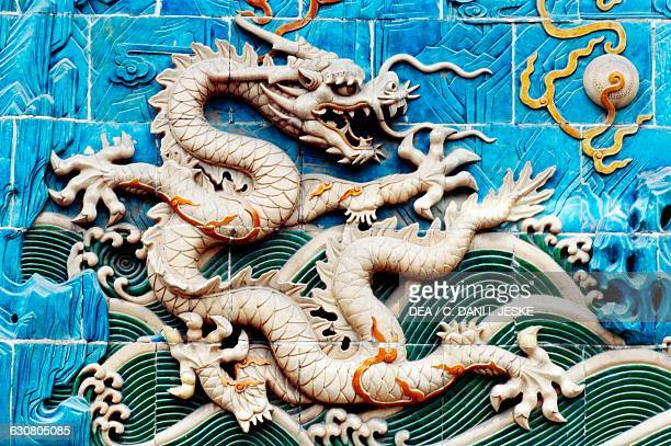Dragon playing with fiery pearls polychrome glazed majolica tiles detail from the NineDragon wall Beihai park Beijing China 18th century