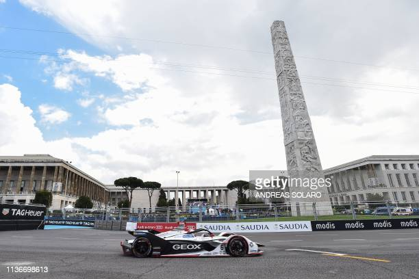 Dragon Racing's German driver Maximilian Gunther steers his car past Obelisk of Marconi during qualifications ahead of the Rome EPrix leg of the...