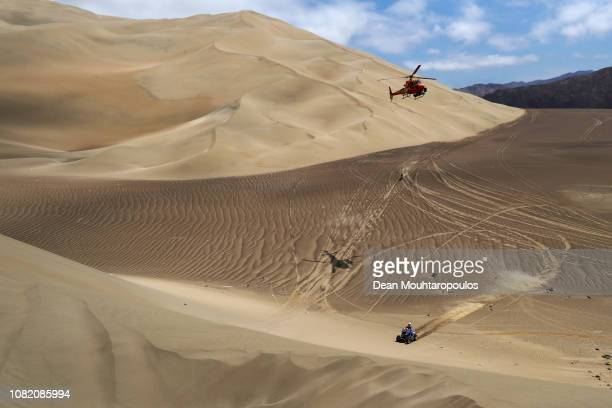 Drag'on Rally Team Yamaha Yfm700r No 240 Quadbike ridden by Nicolas Cavigliasso of Argentina competes in the desert on the sand during Stage Six of...