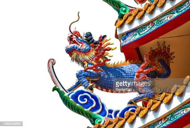 dragon sculpture on white background - dragon stock pictures, royalty-free photos & images