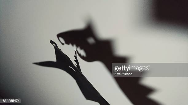 dragon shadow puppet - monster fictional character stock pictures, royalty-free photos & images