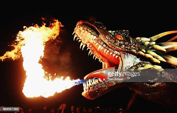 """Dragon statue emits fire as people look on during the Sydney premiere of """"Game Of Thrones"""" at Sydney Opera House on April 13, 2015 in Sydney,..."""