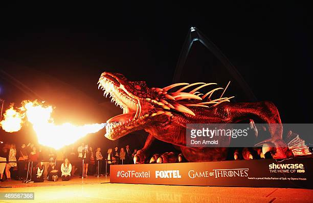 A dragon statue emits fire as people look on during the Sydney premiere of Game Of Thrones at Sydney Opera House on April 13 2015 in Sydney Australia