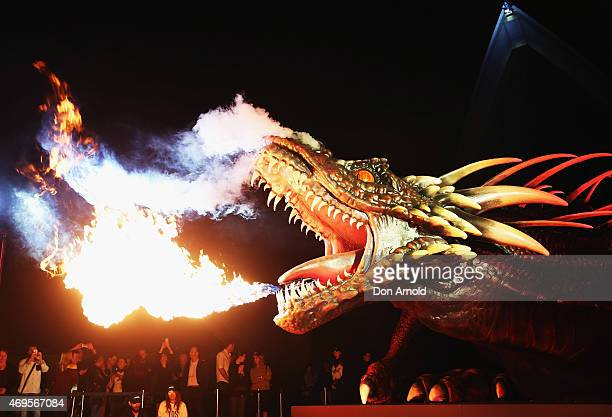 """Dragon statue emits fire as people look on the Sydney premiere of """"Game Of Thrones"""" at Sydney Opera House on April 13, 2015 in Sydney, Australia."""