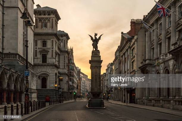 Dragon statue marks the boundary of the City of London and the western end of Fleet Street, taken in the early morning rush hour during the...
