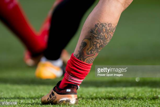 A dragon tattoo on the left leg of Angel Correa of Atletico de Madrid prior to the La Liga 201718 match between Atletico de Madrid and Girona FC at...