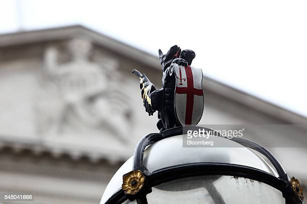 A dragon the symbol for the City of London sits in front of the Bank of England ahead of the bank's financial stability report news conference in the...