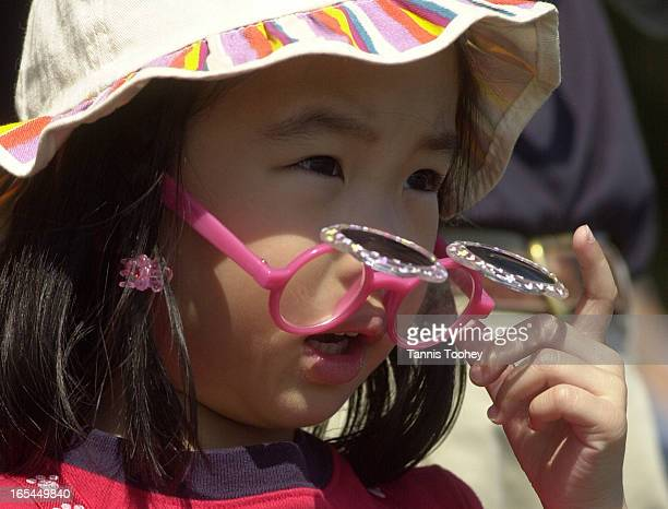 June 24 2001Renee Chan 4 years old tries for a better look at the action during the final heat of Dragon Boat Races as they paddle past her spot on...