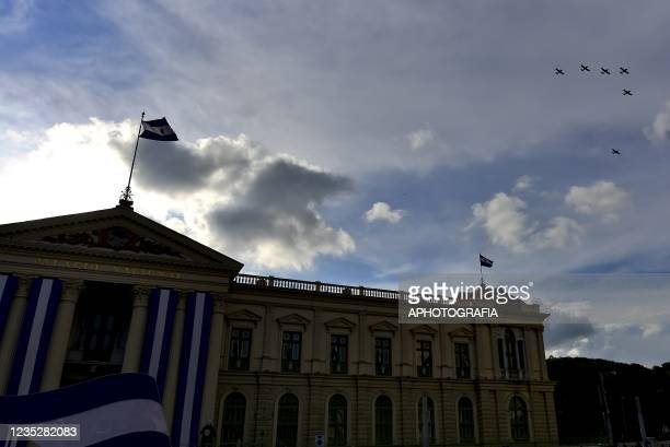 Dragonfly A-37 planes fly over the National Palace as part of the Independence day celebrations on September 15, 2021 in San Salvador, El Salvador....