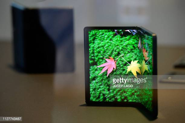 DragonHinge foldable prototype is displayed at the Mobile World Congress in Barcelona on February 27, 2019. - Phone makers will focus on foldable...