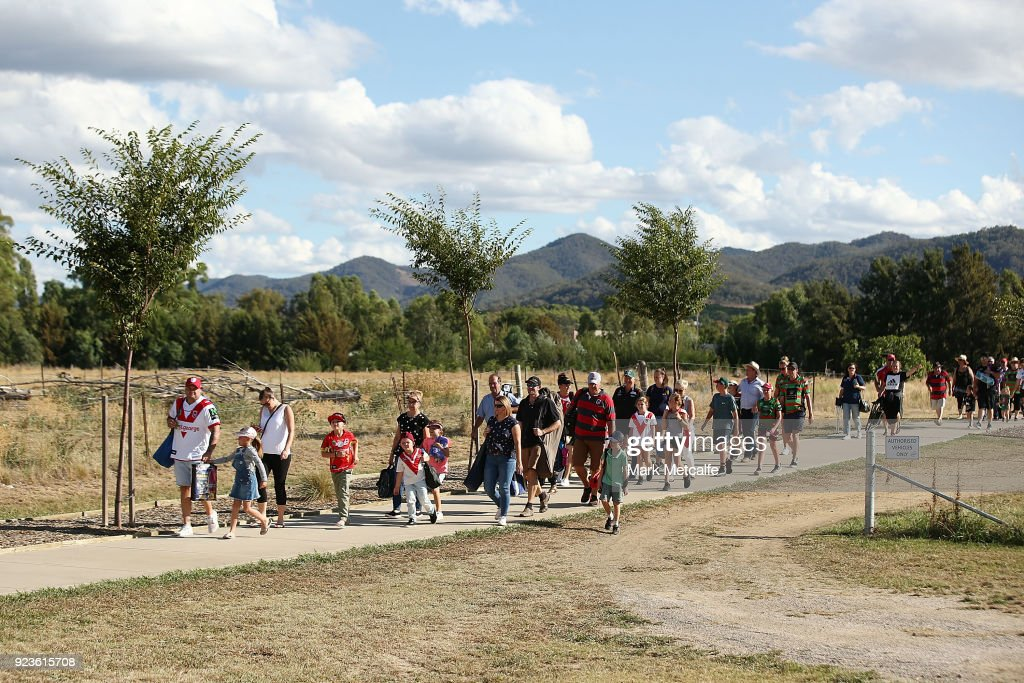 Dragons and Rabbitohs fans walk to the NRL trial match between the South Sydney Rabbitohs and the St George Illawarra Dragons at Glen Willow Regional Sports Stadium on February 24, 2018 in Mudgee, Australia.
