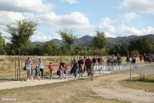 Dragons and Rabbitohs fans walk to the NRL trial match between the South Sydney Rabbitohs and the St George Illawarra Dragons at Glen Willow Regional...