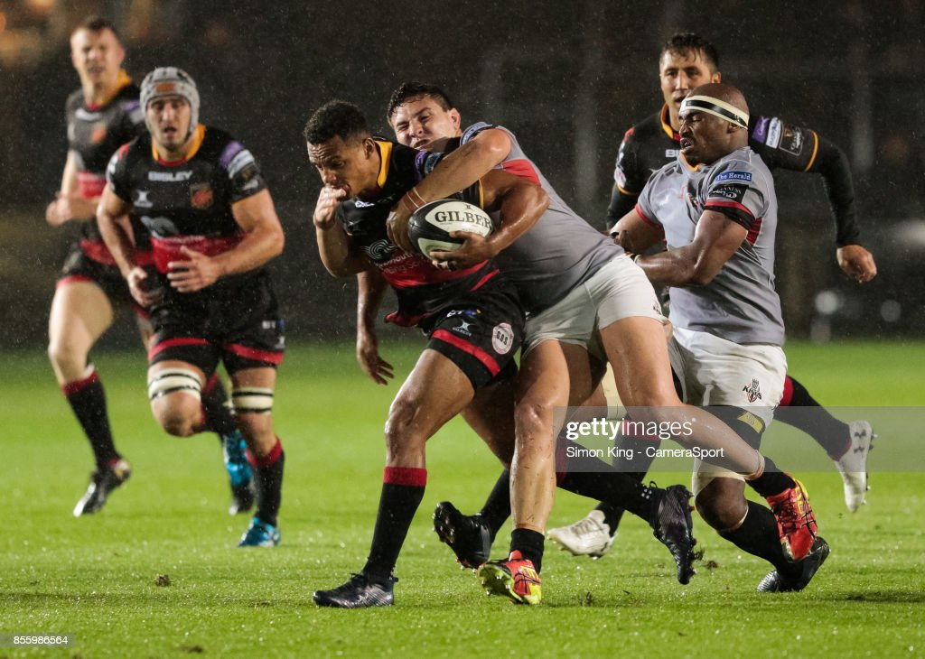 Dragons' Ashton Hewitt under pressure from Southern Kings' Michael Willemse during the Guinness Pro14 Round 5 match between Dragons and Southern Kings at Rodney Parade on September 30, 2017 in Newport, Wales.
