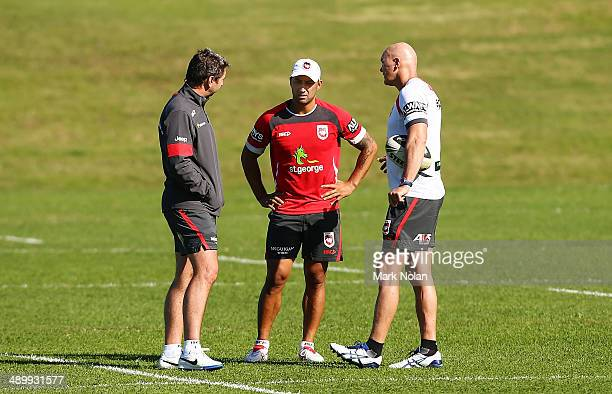 Dragons coach Steve Price, Benji Marshall and Paul McGregor chat during a St George Illawarra Dragons NRL training session at WIN Stadium on May 13,...