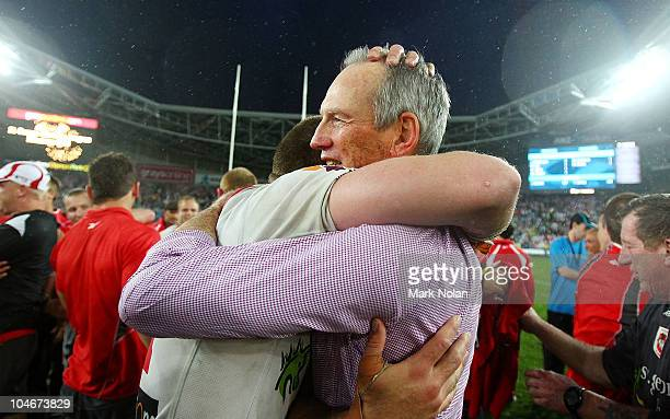 Dragons coach Wayne Bennett embraces one of his players after the NRL Grand Final match between the St George Illawarra Dragons and the Sydney...
