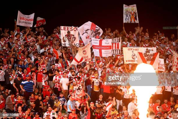 Dragons fans celebrates after a try during the round one NRL match between the St George Illawarra Dragons and the Brisbane Broncos at UOW Jubilee...