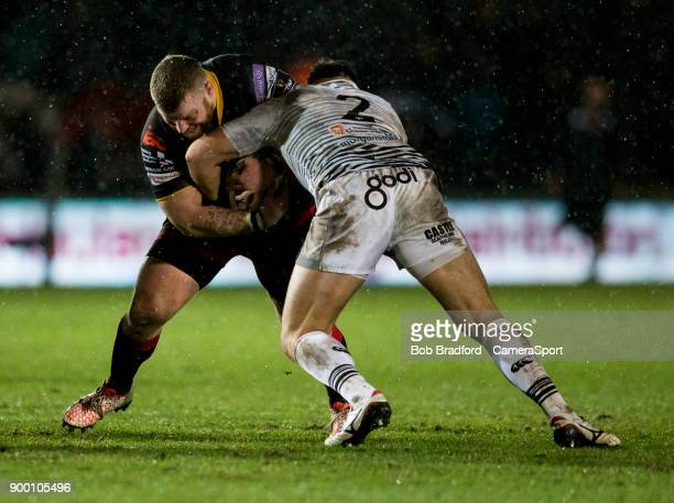 Dragons' Lloyd Fairbrother is tackled by Ospreys' Scott Baldwin during the Guinness Pro14 Round 12 match between Dragons and Ospreys at Rodney Parade...