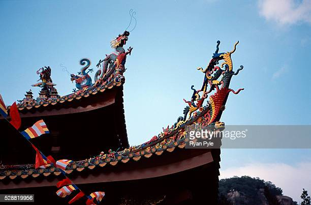 Dragons on the rooftop at the Nanputuo Temple in Xiamen. The Nanputuo Temple is located on the southeast of Xiamen Island. It is surrounded by the...