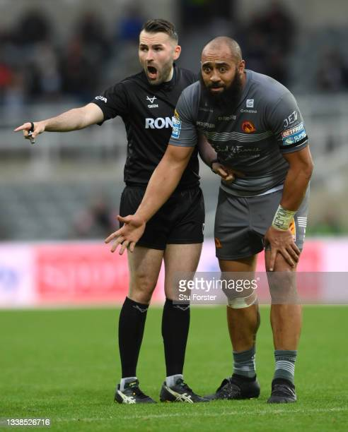 Dragons player Sam Kasiano and referee Liam Moore react during the Betfred Super League match between St Helens and Catalans Dragons at St James'...