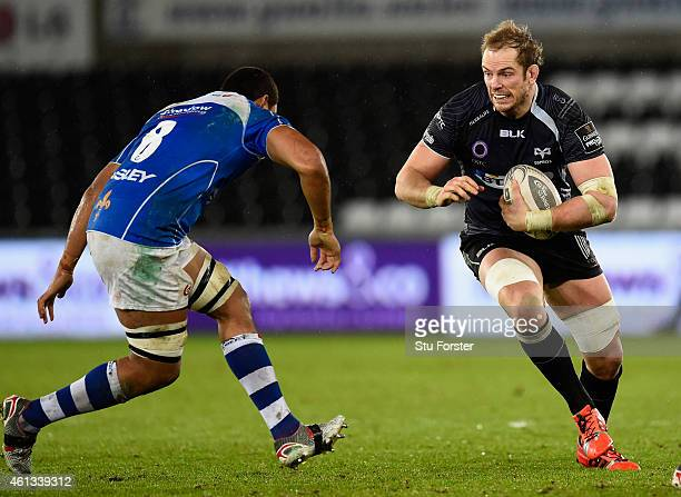 Dragons player Taulupe Faletau faces up to the run of Alun Wyn Jones of the Ospreys during the Guinness Pro 12 match between Ospreys and Newport...