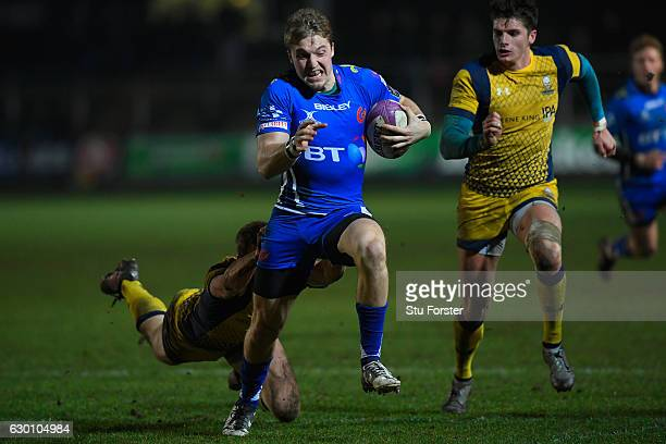 Dragons player Tyler Morgan races through to score during the European Rugby Challenge Cup match between Newport Gwent Dragons and Worcester Warriors...