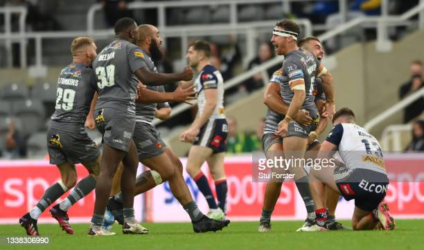 Dragons players celebrate after James Maloney had scored the winning points with a drop goal during the Betfred Super League match between St Helens...