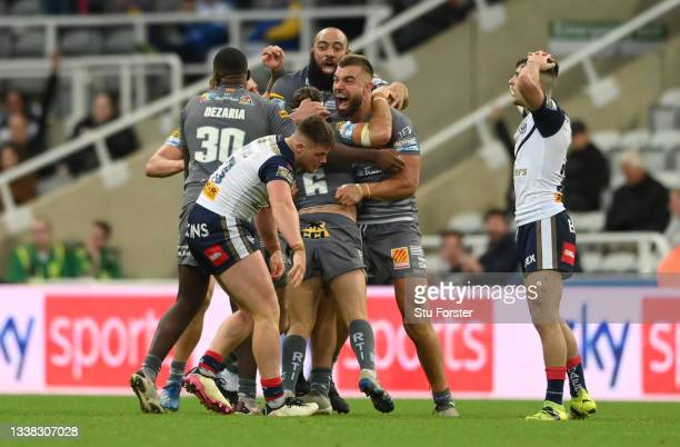 Dragons players celebrate after James Maloney ) had scored the winning points with a drop goal during the Betfred Super League match between St...